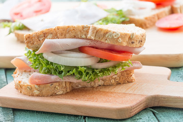 club sandwich on green wood