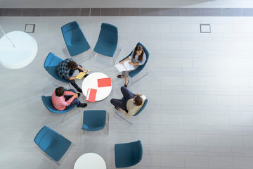 Overhead view of meeting in engineering facility