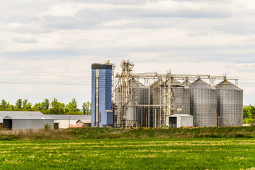 Agricultural grain dryer complex. Modern granary with weighing station.
