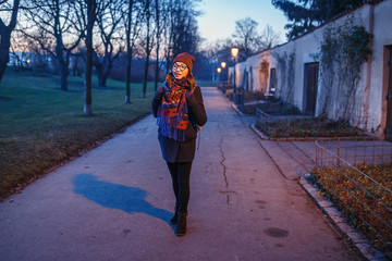Woman walking at late Evening in the Park