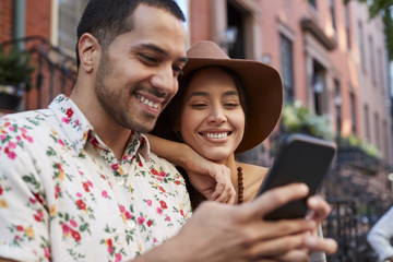 Couple Posing For Selfie On Street In New York City