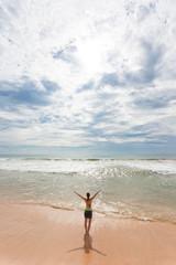 Sri Lanka - Ahungalla - A woman enjoying the sunshine at the beach