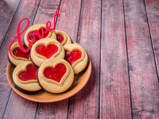 Homemade Cookies with a Red Jam Heart Valentine's Day Dark Wooden Background Copy Space