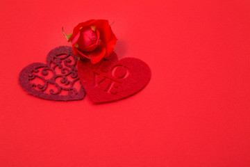 Valentine's day greeting card in red with felt hearts and scarlet rose