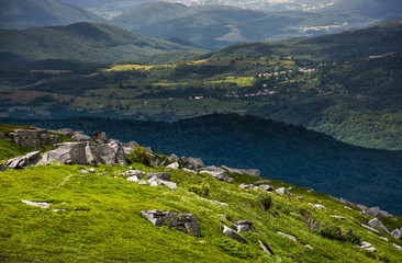 grassy meadow with rocky formations in mountains. lovely summer landscape. location Runa mountain, Carpathians, Ukraine