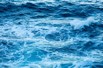 Waves of the sea in a swell along the coast