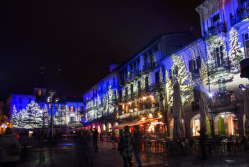 bars and restaurants with Christmas illuminations in the famous Como's square. Italy