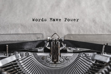 words have power - words, phrase. retro vintage aged typewriter with white blank sheet of paper