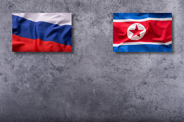 North Korea and Russia flags. North Korea and Russia flag on concrete background