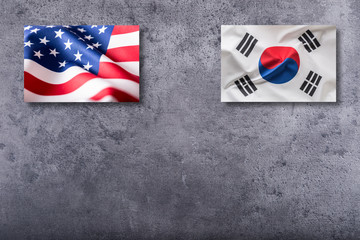 American and Soutth korea flags. Usa and South korea flag on concrete background
