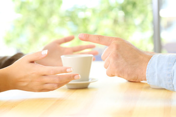 Friends hands arguing in a restaurant or home