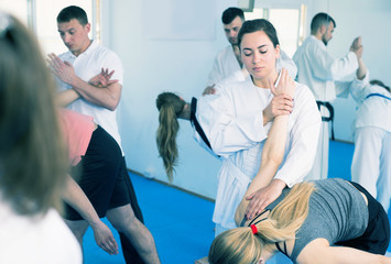 Adults training in pairs at taekwondo class