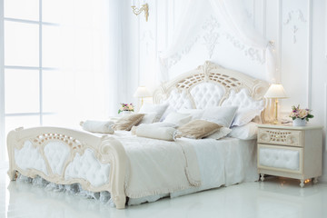 Decor in the bedroom in the style of rococo.