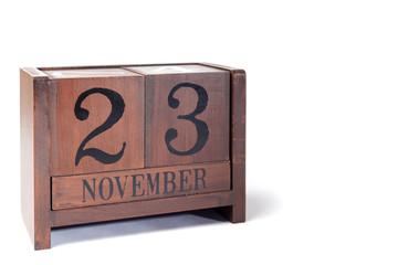 Wooden Perpetual Calendar set to November 23rd