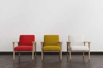 Red, white and yellow armchairs in an empty room