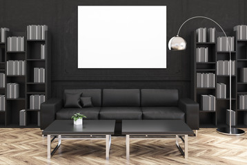 Black living room, black sofa, poster