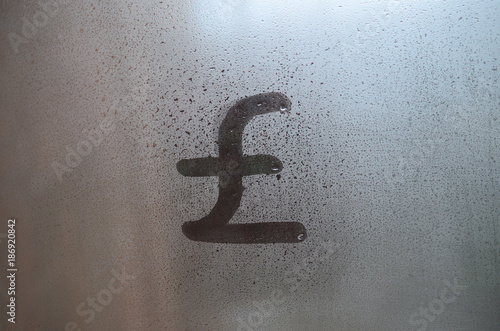 Symbol Of English Pounds Is Written With A Finger On The Surface Of