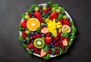 Fruit platter with various fresh strawberry, raspberry, blueberr