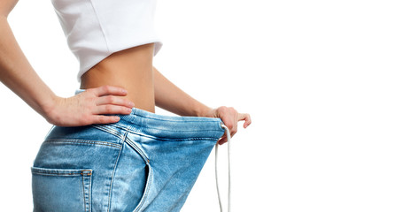 Woman is measuring waist after weight loss,. Diet concept