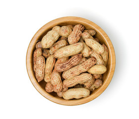 Raw peanut in wooden bowl isolated on white background