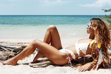 attractive young woman in bikini at the beach