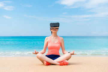 beautiful fitness sporty girl wearing VR device