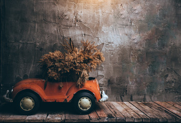 Retro cars on wooden table and Texture old wall background