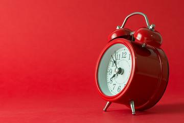 Red classic alarm clock isolated