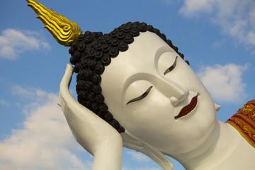 Sleep White buddha statue with blue sky