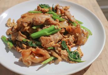 stir fried noodle with pork and kale