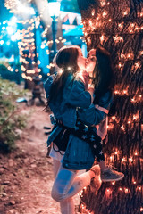 mom kisses her daughter in the evening park