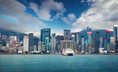 Hong Kong city skyline business center with a dramatic sky .