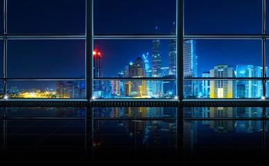 Modern empty and clean office interior with glass windows , Kuala Lumpur city skyline background , night scene .