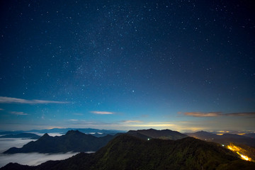 Long explosure and High ISO shot, Beautiful scene before sunrise in the high mountain. Phu chi fa, Chiang rai, Thailand.