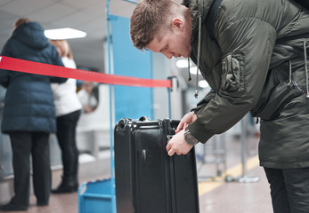 man with the suitcase at the airport