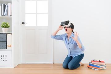 elegant woman wearing virtual reality goggles