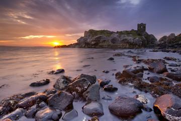 Spectacular sunrise at Kinbane Castle in Northern Ireland