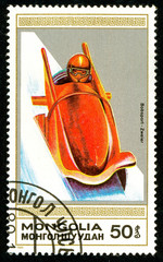 Ukraine - circa 2018: A postage stamp printed in Mongolia shows drawing Bobsled. Series: Winter sports. Circa 1989.