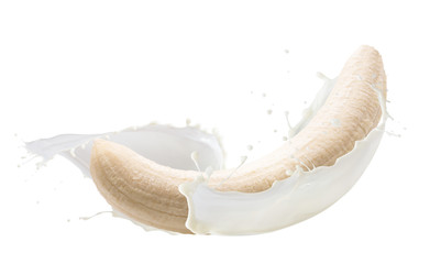 banana in milk splash isolated on a white background