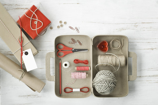 Tinkering utensils in a cardboard box shaped like a case