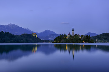 Slovenia, Gorenjska, Bled, Bled Island, Assumption of Mary's Pilgrimage Church and Lake Bled in the evening