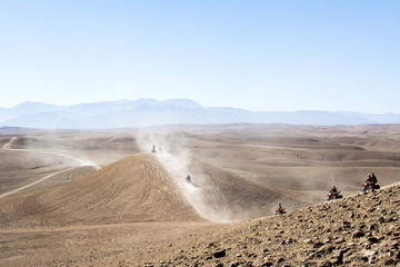 Morocco, Quadbikes in desert of Agafay