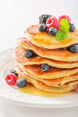 Closeup of american pancakes with blueberries and raspberries