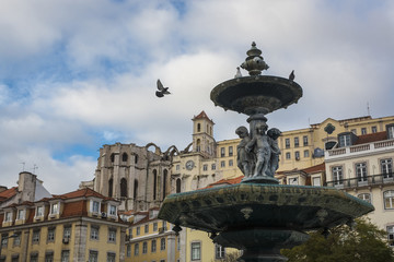 Portugal, Lisbon, fountain and Igreja do Carmo monastery in the background