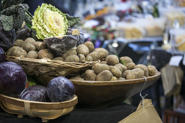 potatoes and cabbage in baskets on the Borough market in London