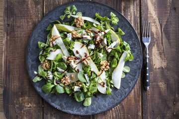 Lamb's lettuce with pear, gorgonzola and walnut on plate