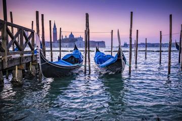 Moored gondolas at dusk, Venice, Italy