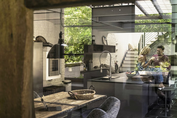 Couple in a luxrious country house kitchen