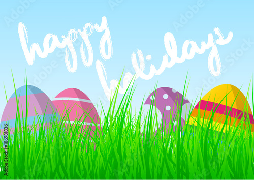 Colorful easter eggs in fresh green grass against blue sky with colorful easter eggs in fresh green grass against blue sky with words happy easter holidays greeting m4hsunfo