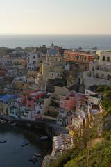 Italy, Campania, Phlegraean Islands, Procida, Marina di Corricella at sunset
